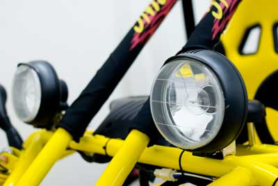 Dual headlights provide safety and help light up the trail.