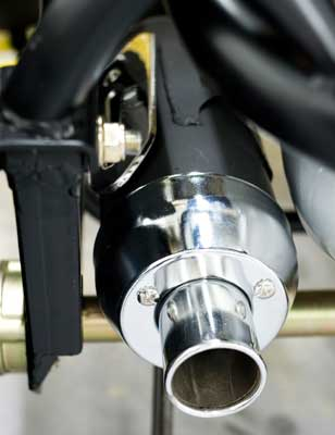 Exhaust features spark arrestor for safe off-road riding.
