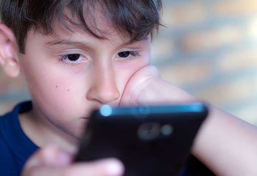 Boy on smartphone device