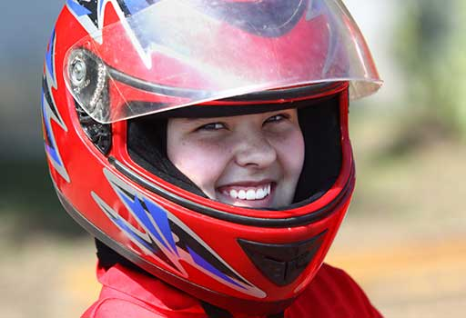 Smiling kid in ATV helmet